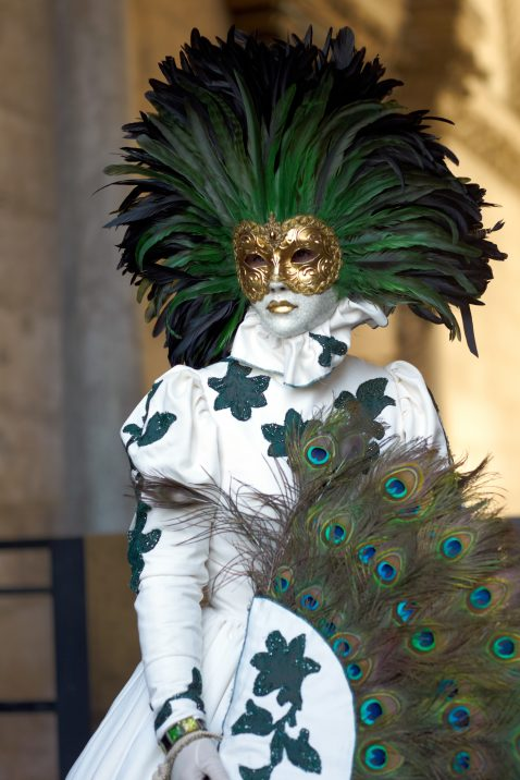 Classical venetians masks used to celebrate carnival in Venice. The Carnival of Venice is an annual festival. The Carnival starts around two weeks before Ash Wednesday and ends on Shrove Tuesday. Venetian people used to wear fancy-dresses not only during the Carnival period but also on many other occasions during the year. Shot in Saint Mark square during 2012 Venice Carnival celebrations.